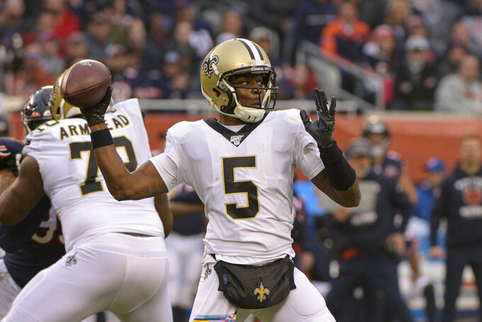 New Orleans Saints quarterback Teddy Bridgewater (5) throws against the Chicago Bears during the first half of an NFL football game in Chicago, Sunday, Oct. 20, 2019. (AP Photo/Mark Black)