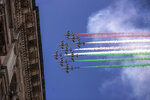 The Frecce Tricolori aerobatic squad of the Italian Air Force flies over Milan, northern Italy, Monday, May 25, 2020 on the occasion of the 74th anniversary of the founding of the Italian Republic on June 2, 1946. This year the acrobatic squad will fly over several Italian cities to bring a message of unity and solidarity during the coronavirus pandemic.(AP Photo/Luca Bruno)