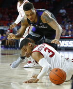 Kansas State forward Levi Stockard III, top and Oklahoma guard Miles Reynolds (3) watch a loose ball during the first half of an NCAA college basketball game in Norman, Okla., Wednesday, Jan. 16, 2019. (AP Photo/Sue Ogrocki)