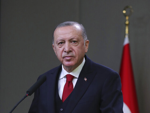 Turkey's President Recep Tayyip Erdogan speaks to reporters before departing for a visit to Azerbaijan, in Ankara, Turkey, Wednesday, Dec. 9, 2020. Erdogan brushed off possible European Union sanctions against Turkey on Wednesday, saying they would not affect his country. Erdogan also accused the EU of acting