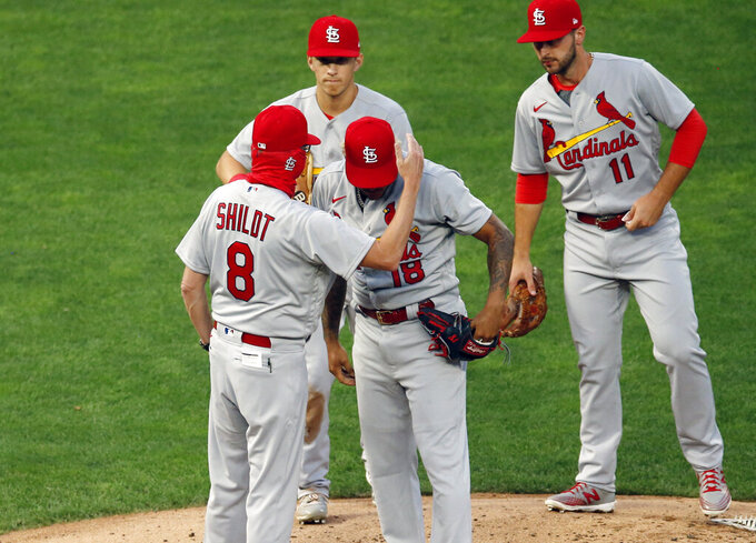 St. Louis Cardinals manager Mike Shildt (8) consoles pitcher Carlos Martinez on the cap as he pulls him following a solo home run by Minnesota Twins' Josh Donaldson in the fourth inning of a baseball game Tuesday, July 28, 2020, in Minneapolis. (AP Photo/Jim Mone)