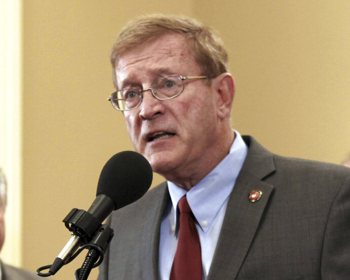 FILE - In this March 15, 2012 file photo, then-Assemblyman Paul Cook, R-Yucca Valley, speaks at a Capitol news conference in Sacramento, Calif. Cook, now the incumbent 8th District Congressman, announced, Tuesday Sept. 17, 2019 that he will not run for re-election to Congress next year, opting to run for a seat on the San Bernardino County Board of Supervisors in 2020.(AP Photo/Rich Pedroncelli, File)