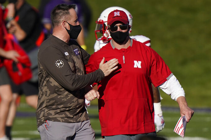 Northwestern head coach Pat Fitzgerald, left, greets Nebraska head coach Scott Frost after an NCAA college football game in Evanston, Ill., Saturday, Nov. 7, 2020. Northwestern won 21-13. (AP Photo/Nam Y. Huh)
