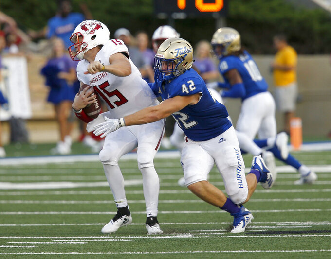 FILE - In this Sept. 15, 2018, file photo, Tulsa's Cooper Edmiston sacks Arkansas State quarterback Justice Hansen during an NCAA college football game, in Tulsa, Okla. Edmiston was the team's leading tackler last season. Tulsa plays at No. 18 Michigan State on Friday, Aug. 31, 2019. (Stephen Pingry/Tulsa World via AP, File)