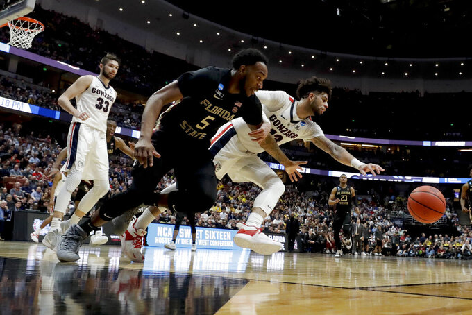 Gonzaga guard Josh Perkins, right, and Florida State guard PJ Savoy chase a loose ball during the second half an NCAA men's college basketball tournament West Region semifinal Thursday, March 28, 2019, in Anaheim, Calif. (AP Photo/Marcio Jose Sanchez)