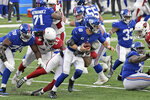 New York Giants quarterback Daniel Jones, center, is sacked during the second half of an NFL football game against the Arizona Cardinals, Sunday, Dec. 13, 2020, in East Rutherford, N.J. (AP Photo/Bill Kostroun)
