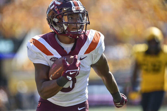 Virginia Tech running back Raheem Blackshear (5) rushes the ball against West Virginia during the second half of an NCAA college football game in Morgantown, W.Va., Saturday, Sep. 18, 2021. (AP Photo/William Wotring)