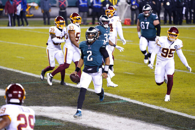Philadelphia Eagles' Jalen Hurts (2) scores a touchdown during the first half of an NFL football game against the Washington Football Team, Sunday, Jan. 3, 2021, in Philadelphia. (AP Photo/Chris Szagola)