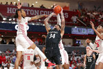 Cincinnati guard Jarron Cumberland (34) attempts to put up a shot between Houston guard Caleb Mills, left, and forward Fabian White Jr. (35) during the first half of an NCAA college basketball game Sunday, March 1, 2020, in Houston. (AP Photo/Michael Wyke)