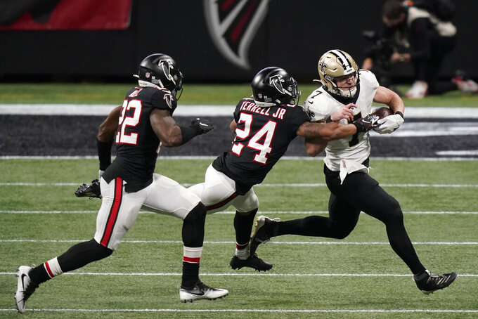 New Orleans Saints quarterback Taysom Hill (7) runs against Atlanta Falcons cornerback A.J. Terrell (24) during the second half of an NFL football game, Sunday, Dec. 6, 2020, in Atlanta. (AP Photo/Brynn Anderson)
