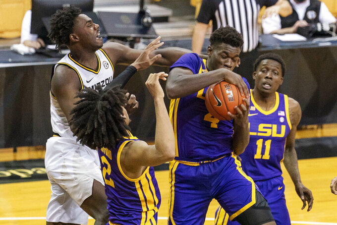 Missouri's Kobe Brown, from left, LSU's Trendon Watford, Darius Days, and Josh LeBlanc Sr. battle for a rebound during the second half of an NCAA college basketball game Saturday, March 6, 2021, in Columbia, Mo.  (AP Photo/L.G. Patterson)