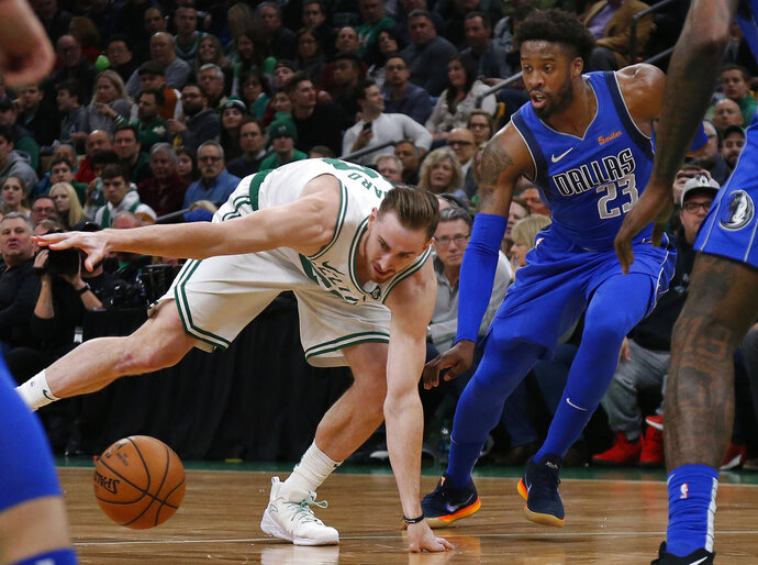 Boston Celtics forward Gordon Hayward (20) loses control of the ball next to Dallas Mavericks guard Wesley Matthews (23) during the first quarter of an NBA basketball game Friday, Jan. 4, 2019, in Boston. (AP Photo/Elise Amendola)