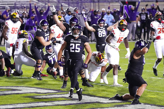 Northwestern running back Isaiah Bowser (25) scores a touchdown during the first half of an NCAA college football game against Maryland in Evanston, Ill., Saturday, Oct. 24, 2020. (AP Photo/Nam Y. Huh)