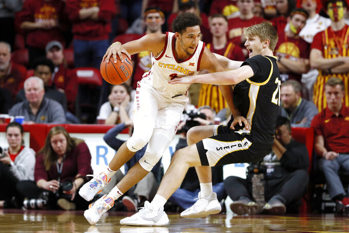 Southern Mississippi forward Hunter Dean is fouled by Iowa State forward George Conditt IV, left, during the second half of an NCAA college basketball game, Tuesday, Nov. 19, 2019, in Ames, Iowa. Iowa State won 73-45. (AP Photo/Charlie Neibergall)