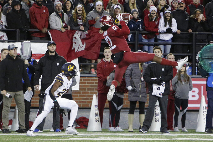 Washington State wide receiver Dezmon Patmon (12) catches a pass in front of California cornerback Josh Drayden during the first half of an NCAA college football game in Pullman, Wash., Saturday, Nov. 3, 2018. (AP Photo/Young Kwak)