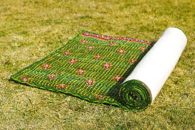 This photo shows the Kantha Sari Yoga Mat, made of recycled cotton saris by Local Women's Handicrafts.  Keep the handmade cards, bouquets or breakfasts in bed coming this Mother's Day, but up your game in celebration of brighter days ahead with a store-bought gift. (Local Women's Handicrafts via AP)