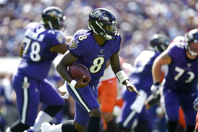 Baltimore Ravens quarterback Lamar Jackson runs with the ball against the Cleveland Browns during the first half of an NFL football game Sunday, Sept. 29, 2019, in Baltimore. (AP Photo/Gail Burton)