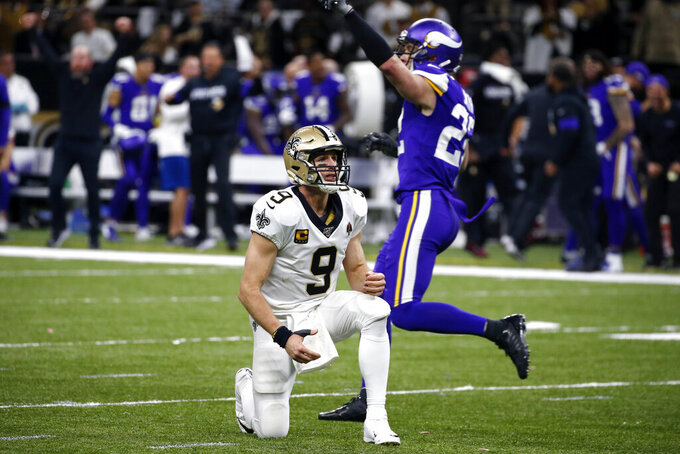 New Orleans Saints quarterback Drew Brees (9) reacts as Minnesota Vikings free safety Harrison Smith (22) celebrates after Brees fumbled, turning over the ball in field goal range, in the second half of an NFL wild-card playoff football game, Sunday, Jan. 5, 2020, in New Orleans. (AP Photo/Butch Dill)