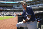 San Diego Padres' Manny Machado stands in the dugout during the second inning of a baseball game against the New York Yankees, Monday, May 27, 2019, in New York. (AP Photo/Michael Owens)
