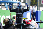 Mercedes driver Valtteri Bottas of Finland celebrates winning the Sprint Race qualifying session at the Monza racetrack, in Monza, Italy , Saturday, Sept.11, 2021. The Formula one race will be held on Sunday. (AP Photo/Luca Bruno)