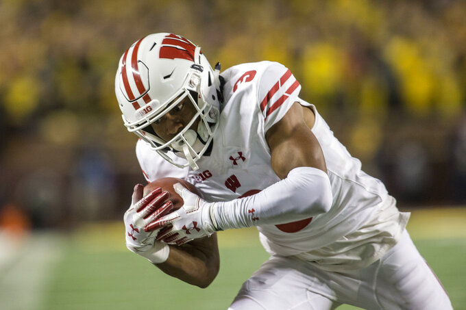 Wisconsin wide receiver Kendric Pryor catches a 27-yard pass for a first down in the fourth quarter of an NCAA college football game against Michigan in Ann Arbor, Mich., Saturday, Oct. 13, 2018. Michigan won 38-13. (AP Photo/Tony Ding)