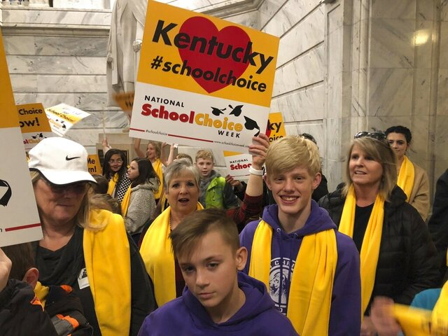 School choice advocates rally at the Kentucky Capitol in Frankfort, Ky., on Monday, Jan. 27, 2020. They are supporting legislation that would give tax credits to people who donate to scholarship funds for special-needs children or those in low-income homes to attend private schools. (AP Photo/Bruce Schreiner)