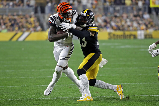 Cincinnati Bengals wide receiver Auden Tate (19) is tackled by Pittsburgh Steelers cornerback Joe Haden (23) during the first half of an NFL football game in Pittsburgh, Monday, Sept. 30, 2019. (AP Photo/Don Wright)