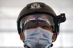 A police officer wearing a face mask to protect against the spread of new coronavirus stands guard at Wuhan Tianhe International Airport in Wuhan in central China's Hubei Province, Wednesday, April 8, 2020. Within hours of China lifting an 11-week lockdown on the central city of Wuhan early Wednesday, tens of thousands people had left the city by train and plane alone, according to local media reports. (AP Photo/Ng Han Guan)