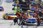 Joey Logano (22) pulls in to make a pit stop behind Aric Almirola during a NASCAR Monster Energy NASCAR Cup Series auto race at Atlanta Motor Speedway, Sunday, Feb. 24, 2019, in Hampton, Ga. (AP Photo/Scott Cunningham)