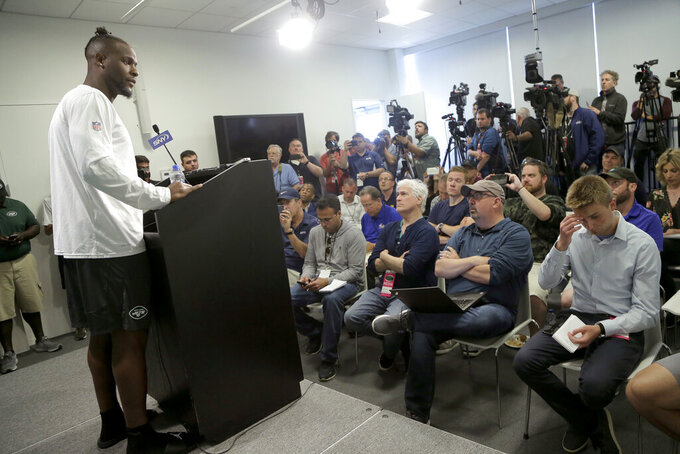 New York Jets running back Le'Veon Bell speaks to reporters at the team's NFL football training facility in Florham Park, N.J., Tuesday, June 4, 2019. (AP Photo/Julio Cortez)