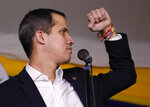 Opposition leader Juan Guaido pumps his fist as he speaks to supporters during a rally at Bolivar Plaza in Chacao, Venezuela, Tuesday, Feb. 11, 2020. Guaido returned home from a tour of nations that back his effort to oust socialist leader Nicolas Maduro. (AP Photo/Ariana Cubillos)