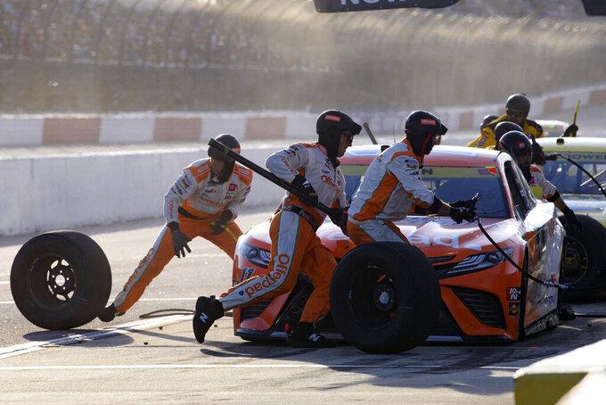Denny Hamlin pit stops during a NASCAR Cup Series auto race Sunday, Sept. 5, 2021, in Darlington, S.C. (AP Photo/John Amis)