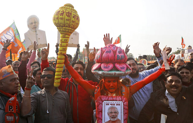In this Monday, Feb. 3, 2020, photo, a supporter of India's ruling Bharatiya Janata Party (BJP) holds a mace, used as a weapon by Hindu god Hanuman, as he shouts slogans during an election campaign rally for the upcoming Delhi elections in New Delhi, India. Campaigning for a crucial state election in India's capital has reached a fever pitch as members of the Hindu nationalist-led government call for violence against minority Muslims and invoke the specter of arch-nemesis Pakistan to reverse course after a pair of losses in recent state polls. (AP Photo/Manish Swarup)