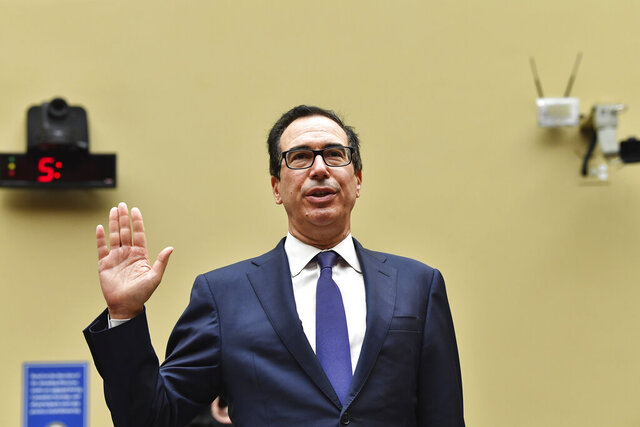 Treasury Secretary Steven Mnuchin is sworn in before the House Select Subcommittee on the Coronavirus Crisis during a hybrid hearing, Tuesday, Sept. 1, 2020, on Capitol Hill in Washington (Nicholas Kamm/Pool via AP)