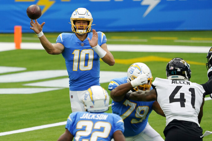 Los Angeles Chargers quarterback Justin Herbert (10) throws against the Jacksonville Jaguars during the first half of an NFL football game Sunday, Oct. 25, 2020, in Inglewood, Calif. (AP Photo/Alex Gallardo)