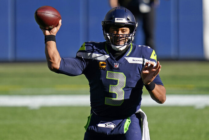 Seattle Seahawks quarterback Russell Wilson passes against the San Francisco 49ers during the first half of an NFL football game, Sunday, Nov. 1, 2020, in Seattle. (AP Photo/Elaine Thompson)