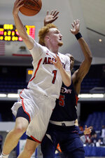 Arizona guard Nico Mannion, left, makes the go-ahead basket against Pepperdine guard Jade' Smith, right, late in an NCAA college basketball game at the Wooden Legacy tournament in Anaheim, Calif., Thursday, Nov. 28, 2019. (AP Photo/Alex Gallardo)