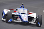 Tony Kanaan, of Brazil, drives through the first turn during qualifications for the Indianapolis 500 auto race at Indianapolis Motor Speedway in Indianapolis, Saturday, May 22, 2021. (AP Photo/Michael Conroy)