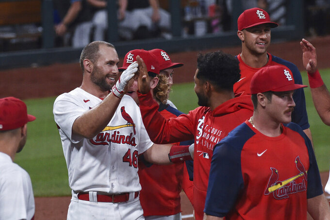 St. Louis Cardinals' Paul Goldschmidt, left, is congratulated by teammates after hitting a home run during the ninth inning of the team's baseball game against the Miami Marlins on Tuesday, June 15, 2021, in St. Louis. (AP Photo/Joe Puetz)