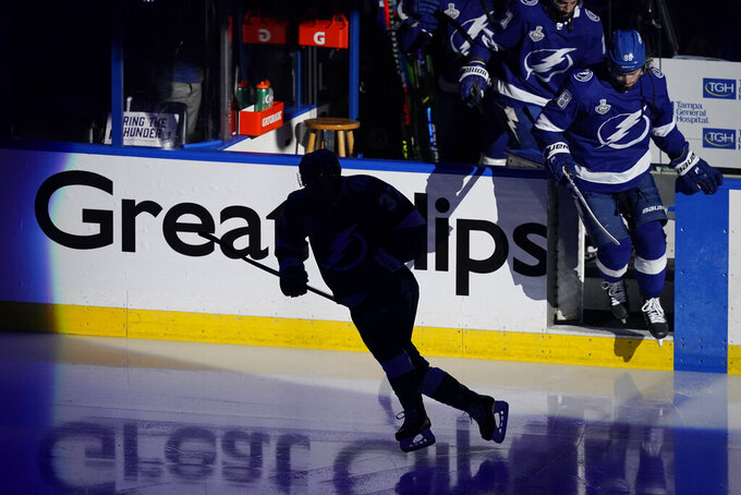 The Tampa Bay Lightning take the ice before the start of the first period in Game 5 of the NHL hockey Stanley Cup finals, Wednesday, July 7, 2021, in Tampa, Fla. (AP Photo/Gerry Broome)