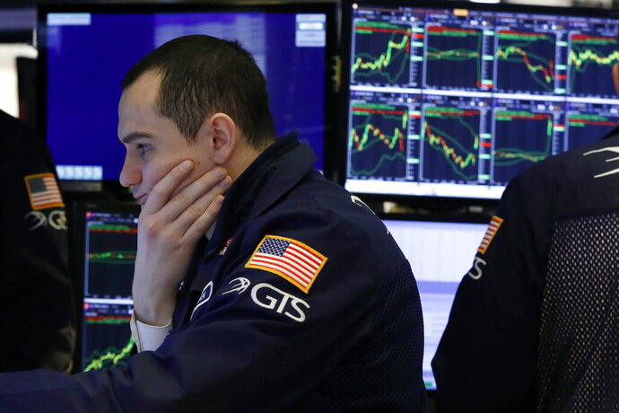 FILE - In this Jan. 9, 2020, file photo specialist Brian Giannettino works on the floor of the New York Stock Exchange. The U.S. stock market opens at 9:30 a.m. EST on Friday, Jan. 24. (AP Photo/Richard Drew, File)