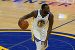 Golden State Warriors forward Draymond Green (23) dribbles against the Toronto Raptors during the second half of an NBA basketball game in San Francisco, Sunday, Jan. 10, 2021. (AP Photo/Jeff Chiu)