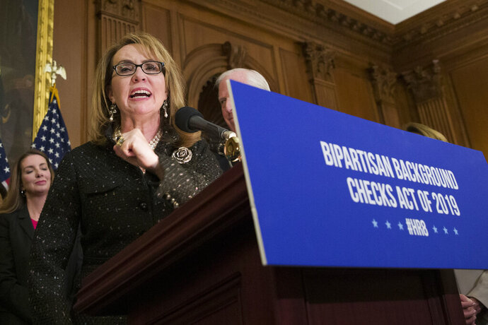 FILE - In this Jan. 8, 2019, file photo, former Rep. Gabby Giffords, speaks during a news conference to announce the introduction of bipartisan legislation to expand background checks for sales and transfers of firearms, on Capitol Hill in Washington. Ten White House hopefuls will participate Wednesday in an all-day forum on gun policy hosted by MSNBC, March for Our Lives and Giffords.  March for Our Lives is the student-led gun control movement sparked by the high school shooting in Parkland, Florida, last year, and Giffords is the advocacy organization set up by former Arizona congresswoman Gabby Giffords, who was shot in the head during a constituent meeting in 2011. (AP Photo/Alex Brandon, File)