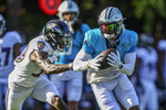 Carolina Panthers wide receiver D.J. Moore, right, runs after a catch against Baltimore Ravens cornerback Chris Westry during a joint practice hosted by Carolina at the NFL football team's training camp in Spartanburg, S.C., Wednesday, Aug. 18, 2021. (AP Photo/Nell Redmond)