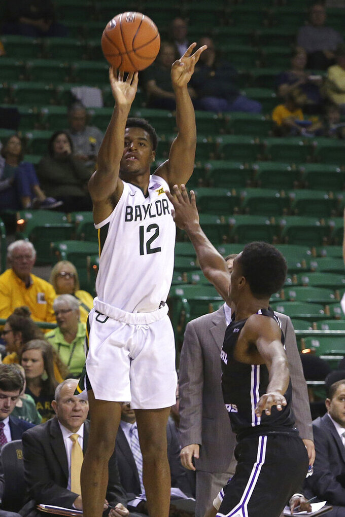 Baylor guard Jared Butler (12) shoots a three-pointer over Central Arkansas guard Lewis McDaniel (2) in the second half of an NCAA college basketball game Tuesday, Nov. 5, 2019, in Waco, Texas. (AP photo/ Jerry Larson)