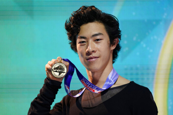 FILE - In this Jan. 17, 2021, file photo, Nathan Chen poses with his gold medal in the men's championship at the U.S. Figure Skating Championships in Las Vegas. Since his disappointing sixth-place finish at the Pyeongchang Olympics, the 22-year-old Chen has won three world titles, the last three of his five U.S. championships, and the two most recent Grand Prix finals. He enters Skate America this weekend as the overwhelming favorite to win his fifth consecutive gold medal. (AP Photo/John Locher, File)