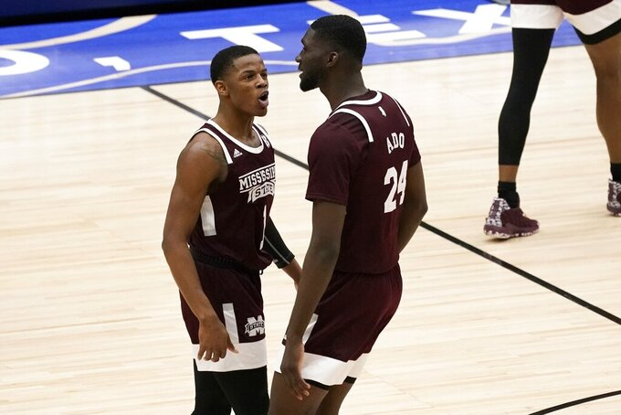 Mississippi State guard Iverson Molinar (1) and forward Abdul Ado (24) celebrate a three-point basket scored by Molinar in the second half of an NCAA college basketball game against Louisiana Tech in the semifinals of the NIT, Saturday, March 27, 2021, in Frisco, Texas. (AP Photo/Tony Gutierrez)