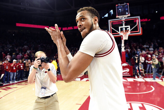 Arkansas forward Daniel Gafford celebrates after beating Mississippi 74-73 during an NCAA college basketball game, Saturday, March 2, 2019 in Fayetteville, Ark. (AP Photo/Michael Woods)