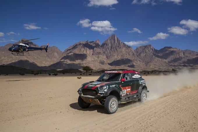 Driver Orlando Terranova, of Argentina, and co-driver Bernardo Graue, of Argentina, race their Mini during stage two of the Dakar Rally, between Al Wajh and Neom, Saudi Arabia, Monday, Jan. 6, 2020. (AP Photo/Bernat Armangue)