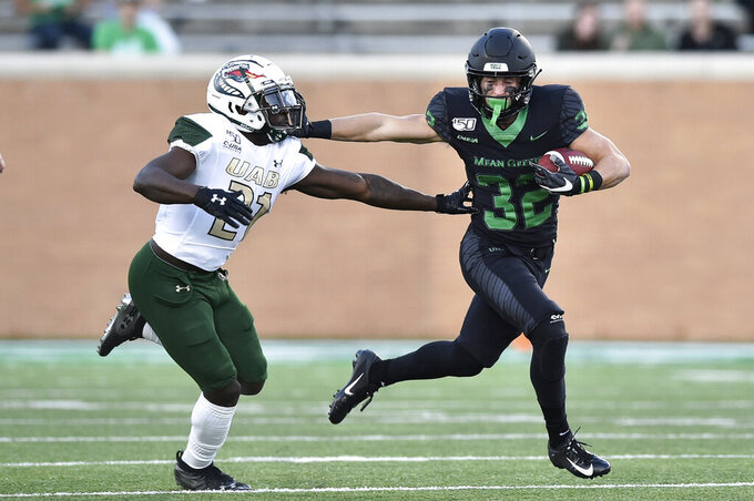 North Texas wide receiver Michael Lawrence (32) stiff-arms UAB defensive back Will Dawkins (21) during the second half of an NCAA college football game Saturday, Nov. 30, 2019, in Denton, Texas. (Jeff Woo/The Denton Record-Chronicle via AP)